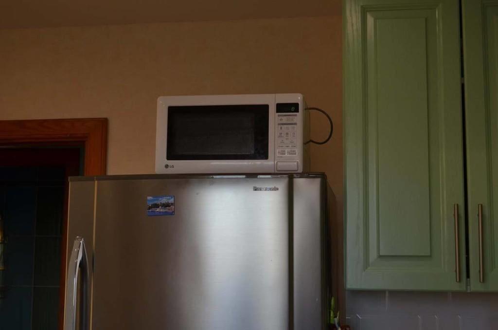 Какой вес можно ставить на крышку холодильника